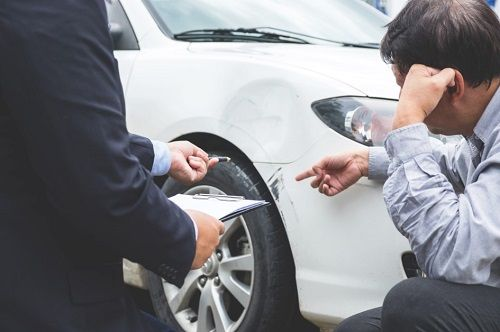 Man and Insurance Broker after a Car Accident